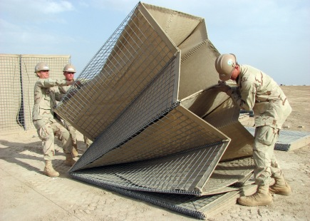 090411-N-8547M-025 HELMAND PROVINCE, Afghanistan (April 11, 2009) Seabees assigned to Naval Mobile Construction Battalion (NMCB) 5 lift a HESCO barrier into alignment during a project at Camp Bastion. NMCB-5 is deployed to Afghanistan providing contingency construction support to allies and members of the NATO International Security Assistance Force (ISAF). NMCB-5 is one of the Naval Expeditionary Combat Command warfighting support elements providing host nation contingency construction support and security. (U.S. Navy Photo by Mass Communication Specialist 2nd Class Patrick W. Mullen III/Released)