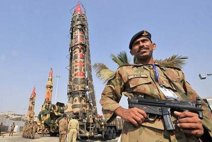 Pakistani Army soldiers guard nuclear-capable missiles at the International Defence Exhibition in Karachi on November 27, 2008. Pakistan's military-run defence industry exports arms and ammunition worth more than 100 million dollars annually to countries in the Middle East, Asia and Africa. AFP PHOTO/Rizwan TABASSUM