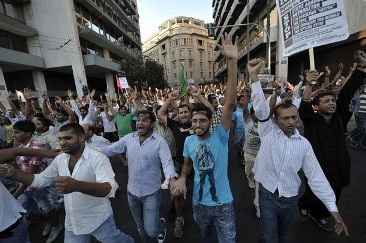 Thousands of people, mainly immigrants from Pakistan, gather at Athens' central Syntagma square on August 24, 2012, during a rally to protest against recent racist attacks on immigrants by ultra nationalist groups. AFP PHOTO / LOUISA GOULIAMAKI (Photo credit should read LOUISA GOULIAMAKI/AFP/GettyImages)