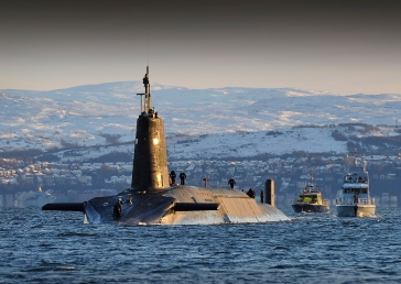 Nuclear submarine HMS Vanguard arrives back at HM Naval Base Clyde, Faslane, Scotland following a patrol.