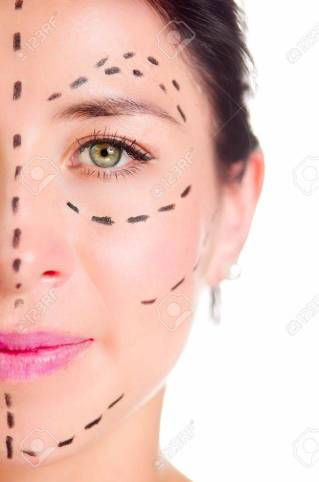 Closeup half of face caucasian woman with dotted lines drawn around left eye, preparing cosmetic surgery